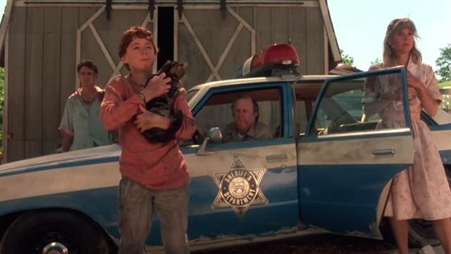 Critters - Brad Scott Grimes holding Bengal tabby cat Chewie with Browns Billy Green Bush Dee Wallace Stone and M. Emmett Walsh