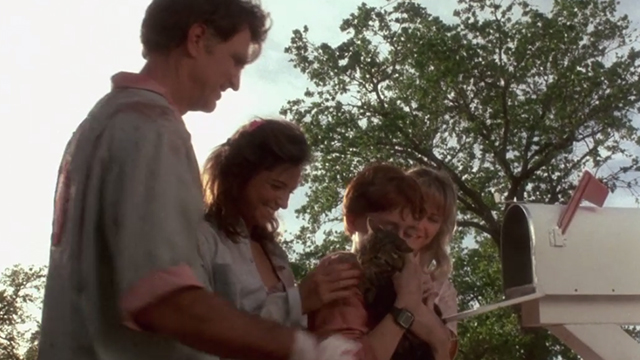 Critters - Brad Scott Grimes holding Bengal tabby cat Chewie with Brown family gathered around Billy Green Bush Dee Wallace Stone and Nadine Van Der Velde