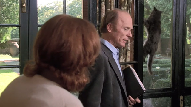 Empire Falls - long haired gray cat Timmy hanging on screen door behind Cindy Kate Burton and Miles Ed Harris