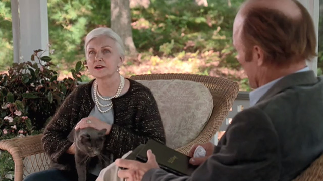 Empire Falls - long haired gray cat Timmy jumping up in Francine Joanne Woodward lap with Miles Ed Harris