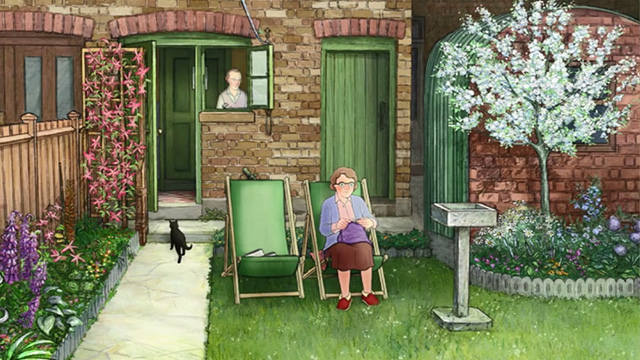 Ethel & Ernest - black cat Susie lying on back of couch behind Ethel & Ernest
