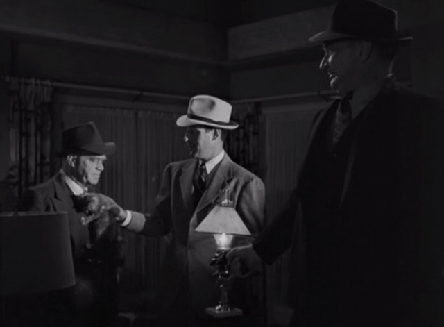 The Falcon Out West - grey kitten handed to Inspector Donovan Cliff Clark by The Falcon Tom Conway