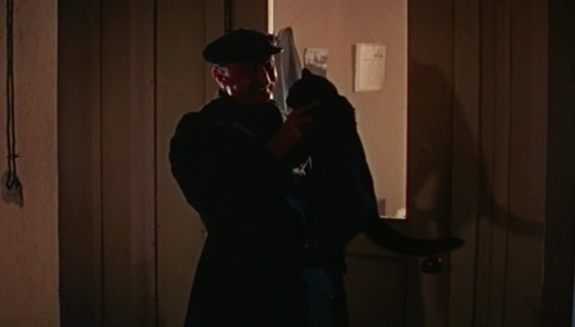 The Fly - night watchman Gaston with black cat Tom