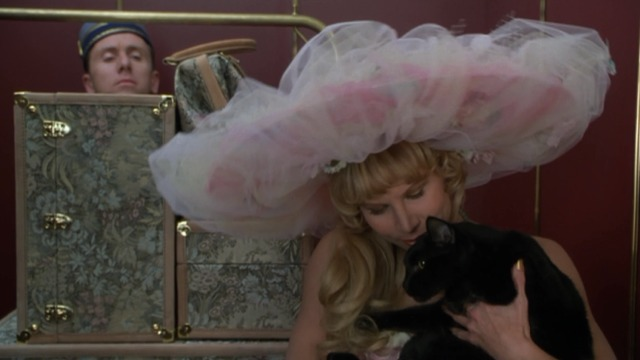 Four Rooms - Jezebel Sammi Davis cuddling with black cat