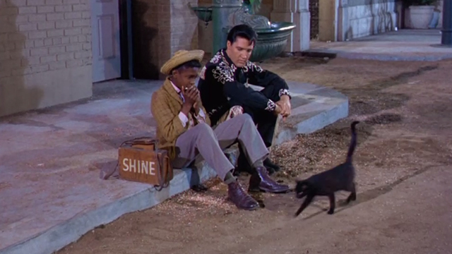 Frankie and Johnny - Johnny Elvis Presley with boy on sidewalk watching black cat pass