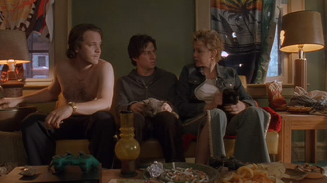 Garden State - grey and black cats on lap of Andrew Zach Braff and Carol Jean Smart on couch with Mark Peter Sarsgaard
