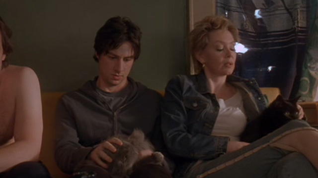Garden State - grey and black cats on lap of Andrew Zach Braff and Carol Jean Smart on couch