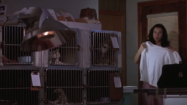 The Getaway - Fran Jennifer Tilly entering room with cats in cages in background