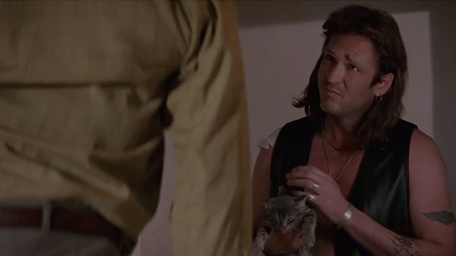 The Getaway - Rudy Michael Madsen holding tabby kitten Kitty while looking at hanging body of Harold