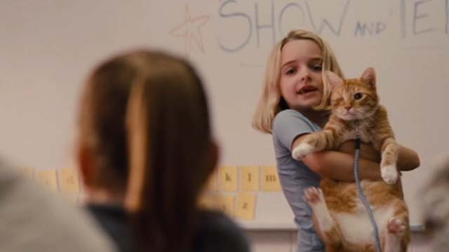 Gifted - one eyed cat Fred being held up by Mary Mckenna Grace in classroom