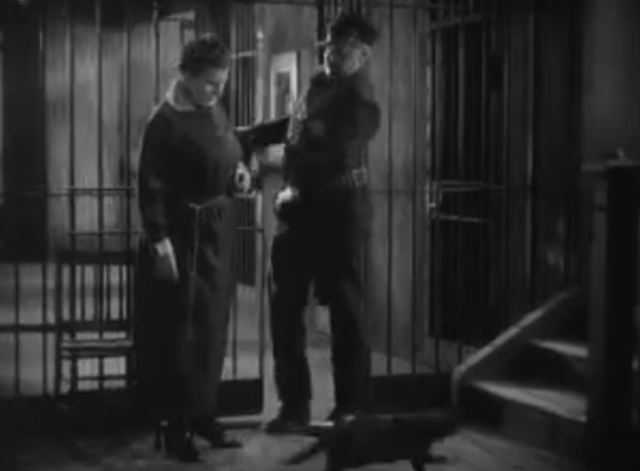 The Godless Girl - black cat running past prison matron and warden Noah Beery