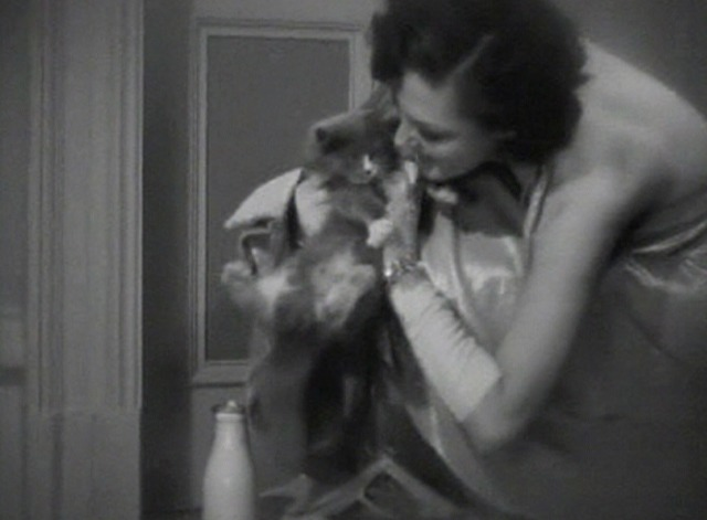 Gold Diggers of 1935 - Winifred Shaw with gray and white kitten outside door