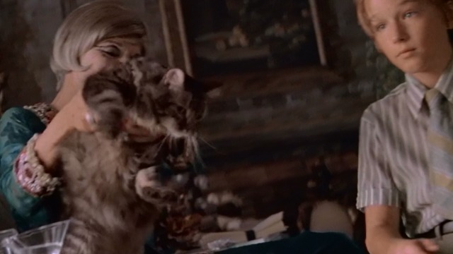 Great Expectations - Ms. Dinsmoor Anne Bancroft lifts Maine Coon cat from lap