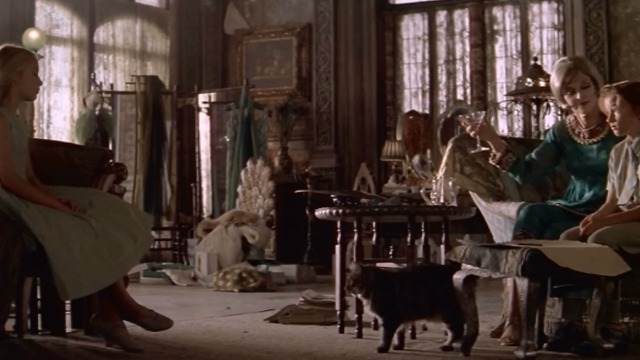Great Expectations - Maine Coon cat on floor between Ms. Dinsmore Anne Bancroft, Finn and Estella