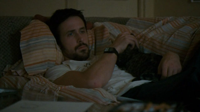 Half Nelson - Dan Dunne Ryan Gosling lying on couch with tabby cat Dave