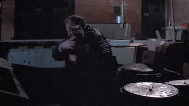 Halloween II - gray cat and security guard Mr. Garrett Cliff Emmich falling backwards into garbage cans