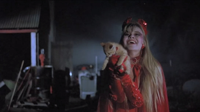 Halloween 5: The Revenge of Michael Meyers - Samantha Tamara Glynn holding up ginger tabby kitten