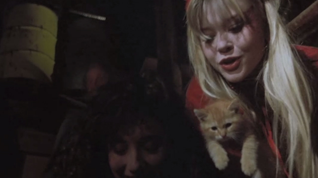 Halloween 5: The Revenge of Michael Meyers - Samantha Tamara Glynn holding ginger tabby kitten with Tina Wendy Kaplan bending over