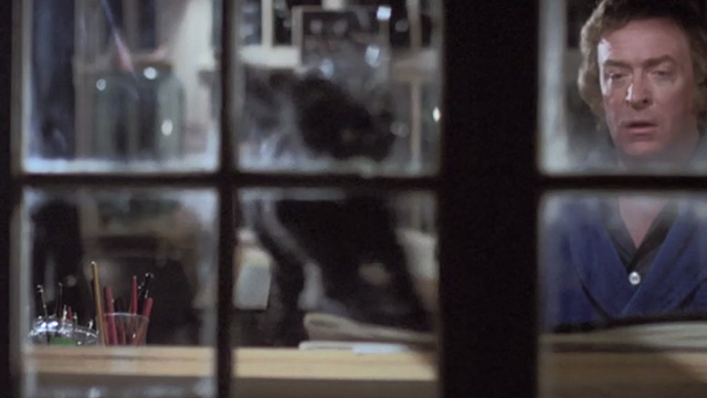 The Hand - black cat Amanda going through window with Jonathan Michael Caine
