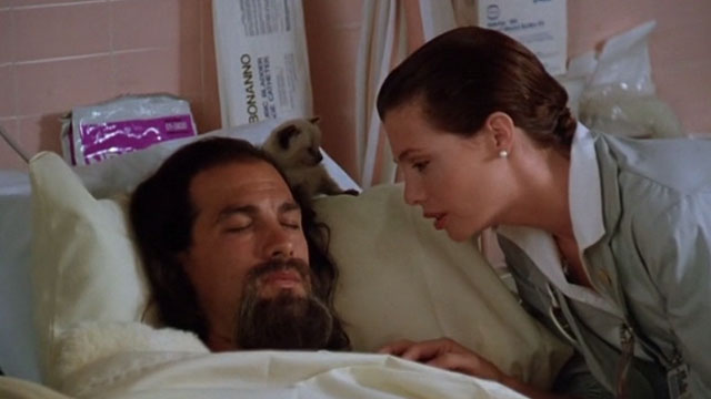 Hard to Kill - Andy Kelly LeBrock with Siamese kitten beside Mason Storm Steven Seagal's head in coma