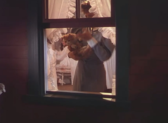 The Harvey Girls - Sonora Cassidy Marjorie Main carrying orange and white tabby cat Arabella to window