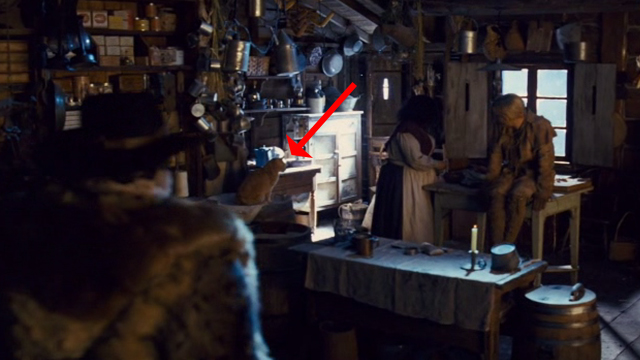The Hateful Eight - cat sitting on counter in general store Minnie's Habadashery