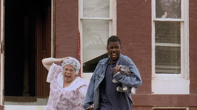 Head of State - Miss Pearl Gammy Singer and Mays Chris Rock holding fake grey cat Dionne as they run from building