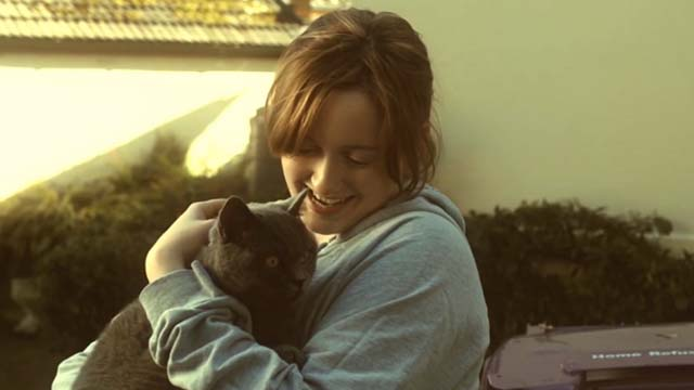 Hell Cat - Happy Charlotte Amy Stephenson holding gray cat Charlie