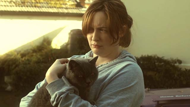 Hell Cat - confused Charlotte Amy Stephenson holding angry gray cat Charlie
