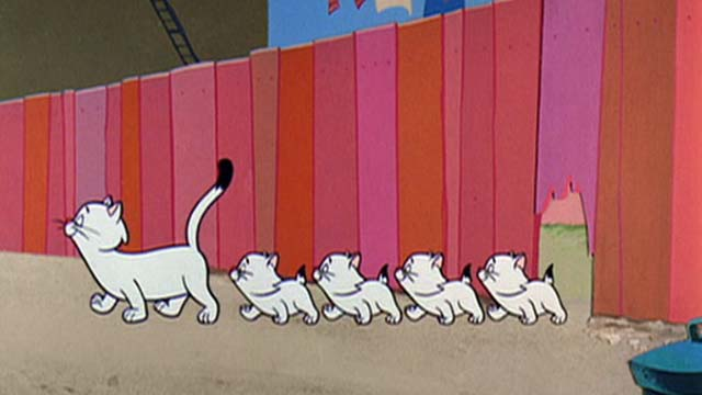 Hey There, It's Yogi Bear - white mother cat and kittens march though hole in fence