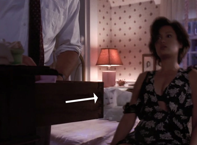 High School High - white cat sitting on bed behind Victoria Tia Carrere