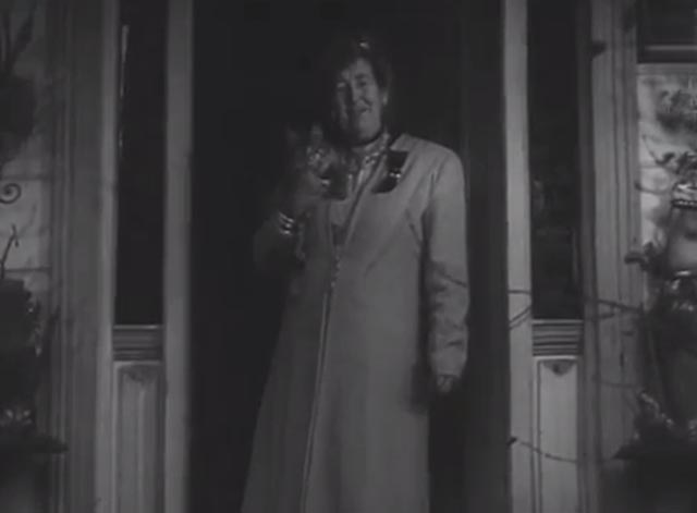 House Full of Snakes - Miss Dorette Collier in doorway with long-haired tabby cat