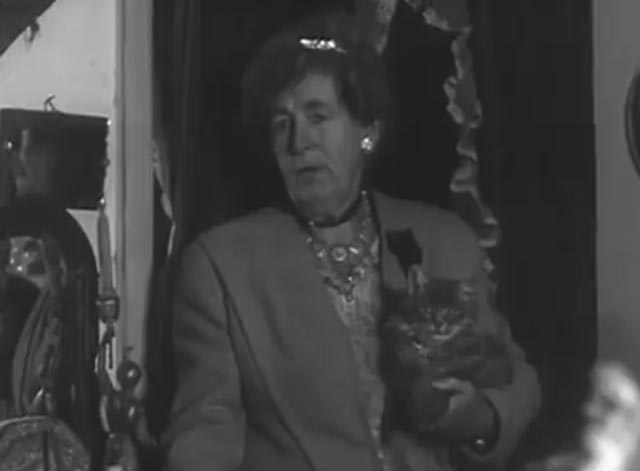 House Full of Snakes - Miss Dorette Collier holding long-haired tabby cat
