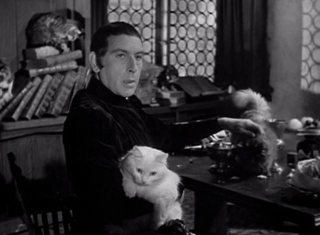 The Hunchback of Notre Dame 1939 - Frollo Cedric Hardwicke holding cat and petting cat in chamber