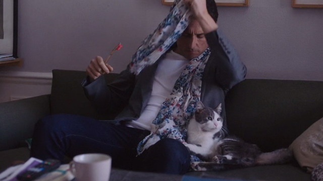 I Am Not an Easy Man - gray and white cat Rocco on couch with Damien Vincent Elbaz