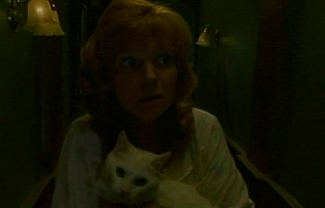 Idle Hands - cat Bones and Anton's mom in hallway