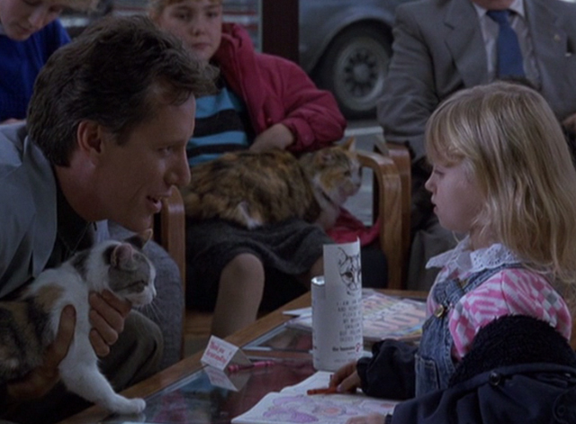 Immediate Family - Michael James Woods holding calico cat and talking to little girl in veterinarian's waiting room