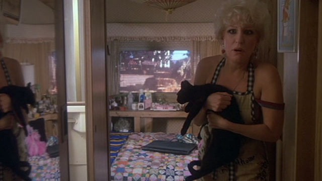 Jinxed! - Bonita Bette Midler clutching black cat Angus in trailer