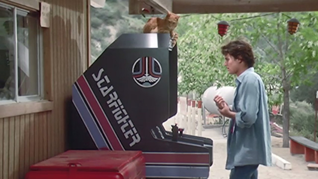 The Last Starfighter - orange tabby cat on top of Starfighter arcade game played by Alex Lance Guest