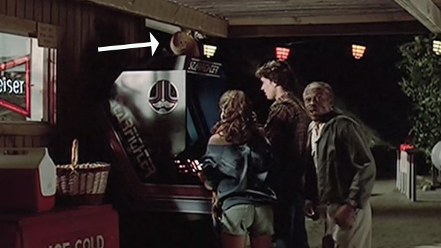 The Last Starfighter - orange tabby cat on top of Starfighter arcade game played by Alex Lance Guest as Maggie approaches