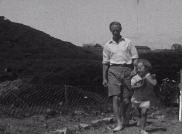Leslie Howard: The Man Who Gave a Damn - Leslie Howard walking alongside daughter Leslie Ruth who is running with a kitten in her arms