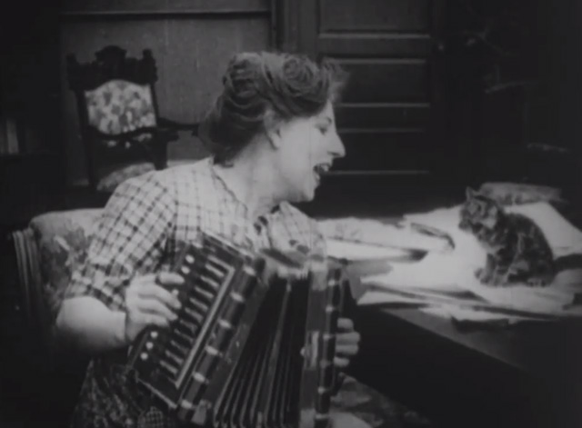 Madcap Ambrose - Rosie Polly Moran playing accordian and serenading tiny tabby kitten