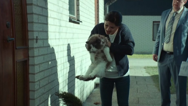 A Man Called Ove - Ragdoll cat being picked up by Parvaneh Bahar Pars with Ove Rolf Lassgårdm