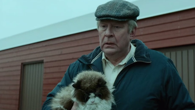 A Man Called Ove - Ragdoll cat being held by Ove Rolf Lassgårdm