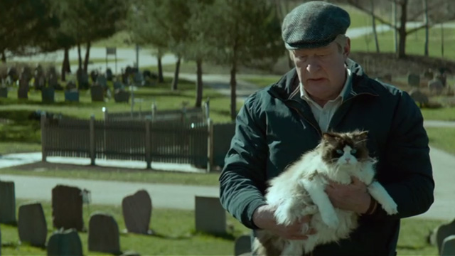 A Man Called Ove - Ragdoll cat being held by Ove Rolf Lassgårdm at cemetery