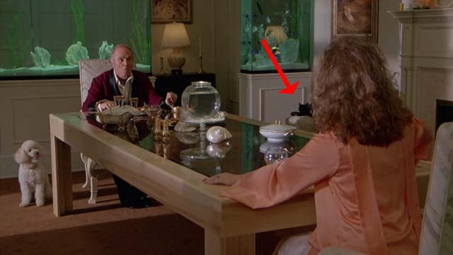 The Man With Two Brains - Timon George Furth and Dolores Kathleen Turner at dinner with black cat on chair in background