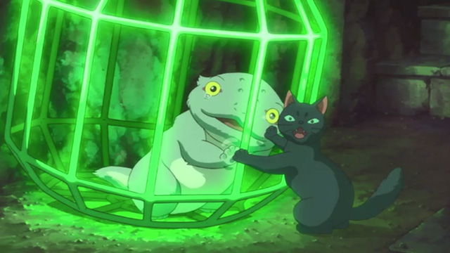 Mary and the Witch's Flower - black cat Tib with transformed gray cat Gib in cage