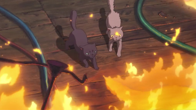 Mary and the Witch's Flower - black cat Tib and gray cat Gib facing fire