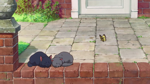 Mary and the Witch's Flower - black cat Tib and gray cat Gib sleeping in sun in front of house