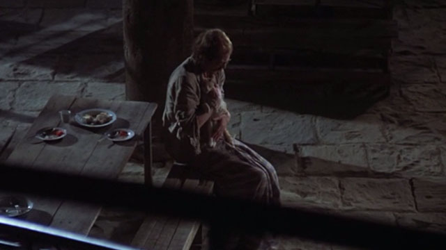 Midnight Express - Max John Hurt sitting and holding dead orange and white cat Higbert